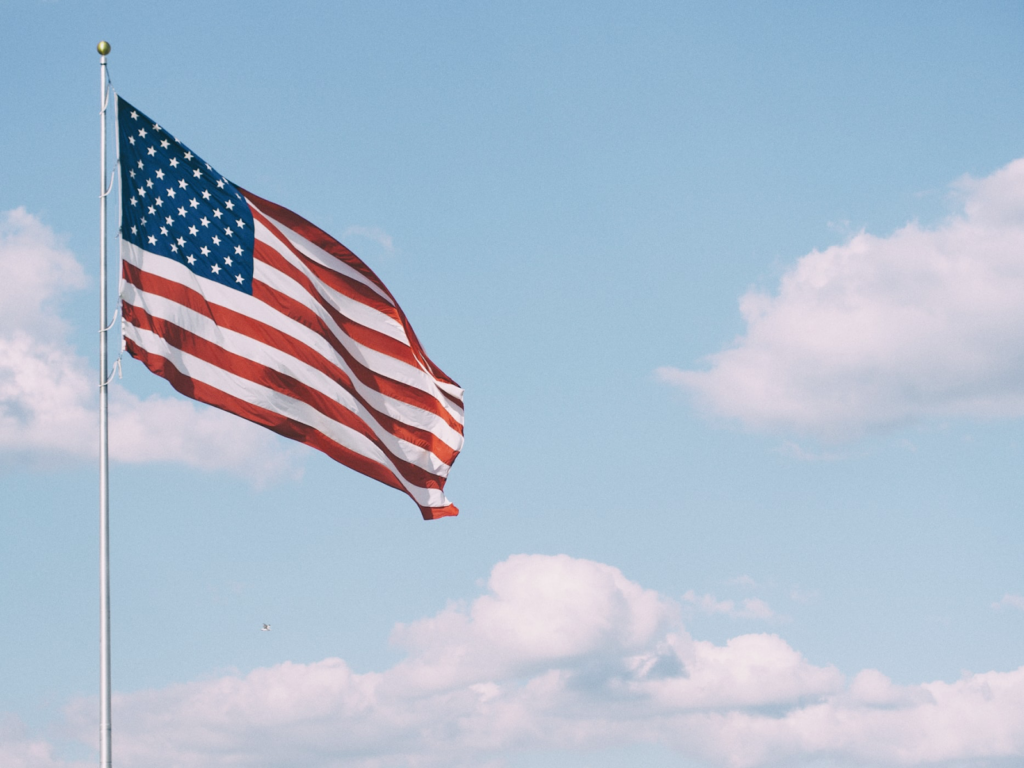 American flag waving in front of blue sky