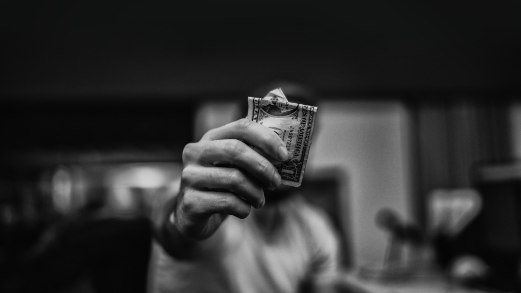 man holding out a $1 bill, B&W